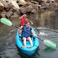 Two girls kayaking at Aloha Beach Camp Summer Camp