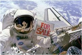 Astronaut Holding For Sale Sign - Source: NASA