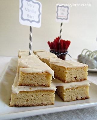 Very vanilla bars on white tray with red licorice and cake balls in the background