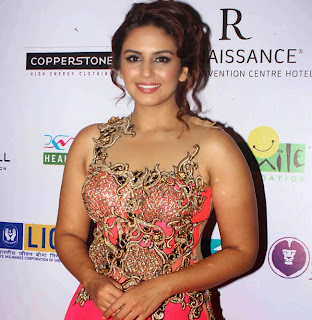 Huma Qureshi in Beautiful Red Sleeveless Choli and red gown at a Fashion Show