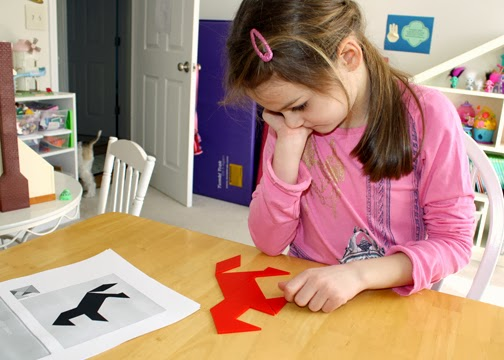 "Earlier in the week, we read ""The Warlord's Puzzle."" Tessa completed a horse tangram on Friday, which I thought was a good way to tie the book and our Chinese New Year theme together."