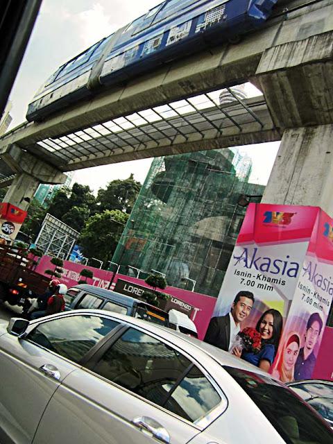busy city street with metro in Kuala Lumpur Malaysia