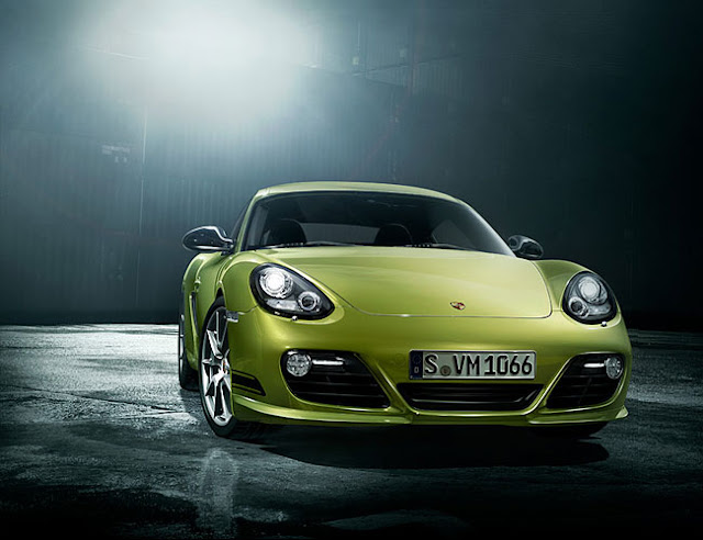 Front view of green 2012 Porsche Cayman R parked at night
