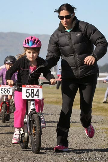 Soraya Alexander, with a helper - 7 years and under five minute race - round five, Endura National Chamopionships, run by Cyclocross Hawke's Bay, at Roy's Hill Reserve, SH50, Fernhill, Hastings photograph