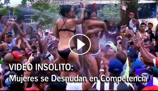 VIDEO INSOLITO: Mujeres se Desnundan en Publico, durante una Feria