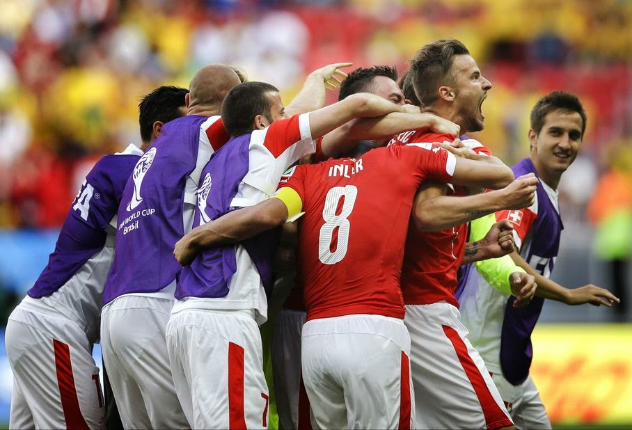 Switzerland's Haris Seferovic, right, celebrates after scoring his side's second goal during the group E World Cup soccer match between Switzerland and Ecuador at the Estadio Nacional in Brasilia, Brazil, Sunday, June 15, 2014.