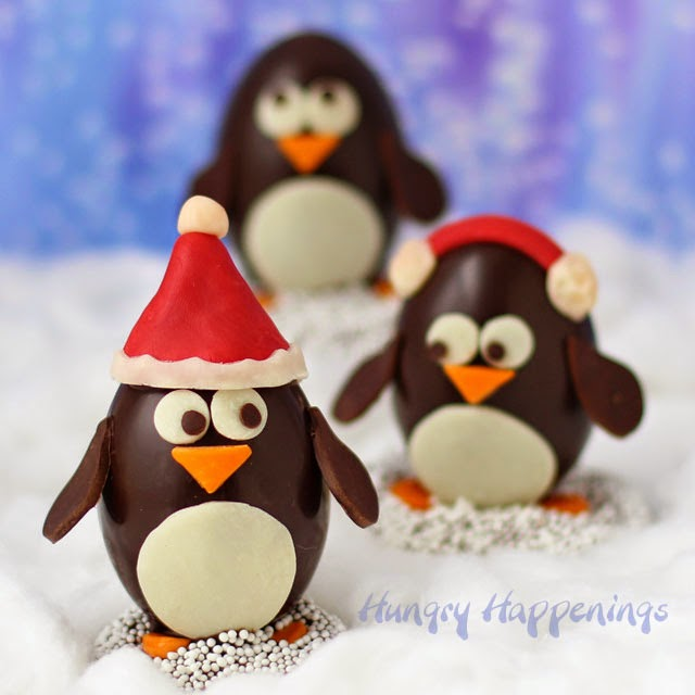 Chocolate Penguin Truffles with White Chocolate Amaretto Raisin Ganache decorated two ways. This version is decorated using modeling chocolate. http://www.hungryhappenings.com