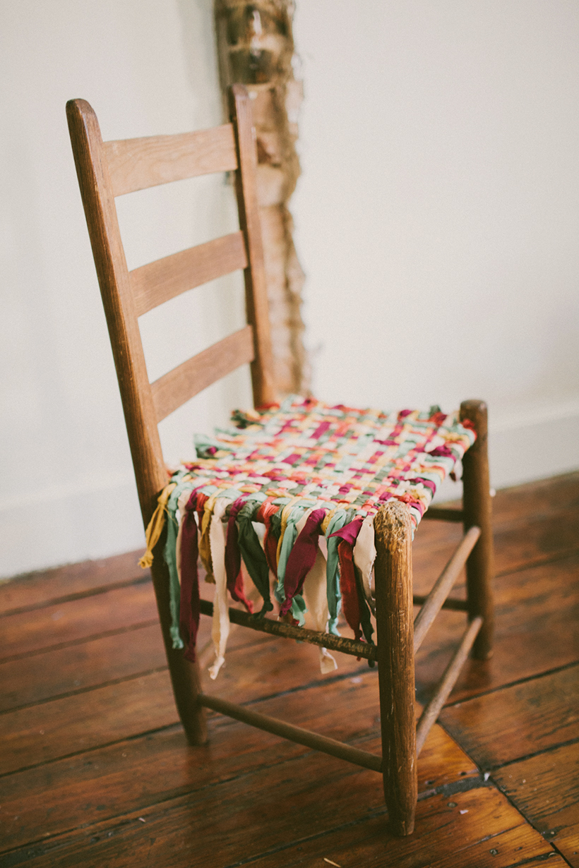 Wooden chair with seat made from woven fabric scrap