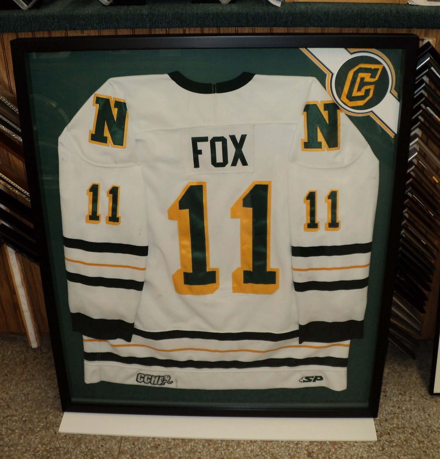 The UP\'s most creative frame shop: Framing NMU hockey jersey