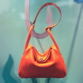 Orange you glad it's summer—Hermès orange bag.