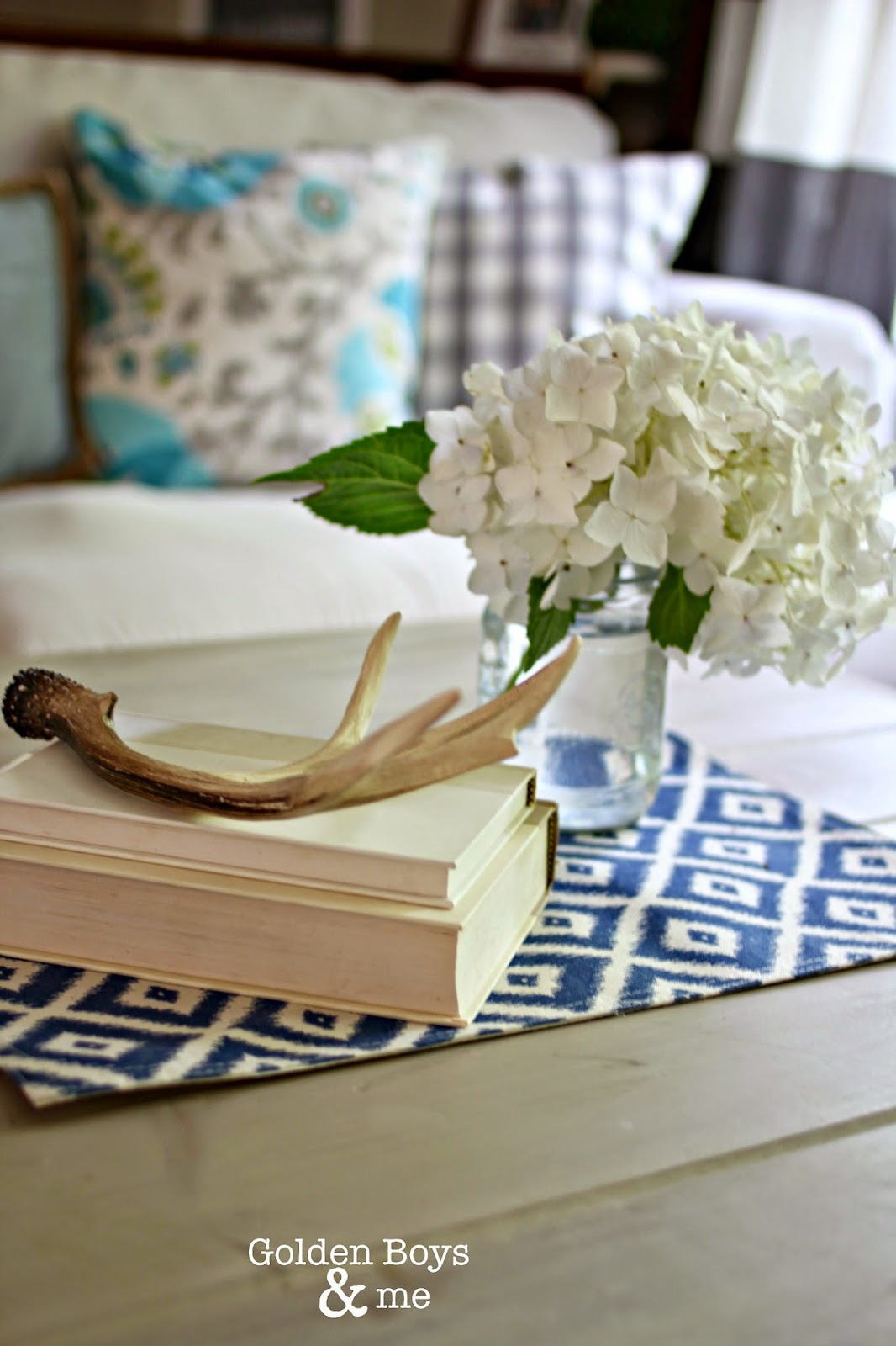 Books with antlers and hydrangea with ikat place mat-www.goldenboysandme.com