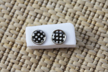 silver rimmed black with white big dots