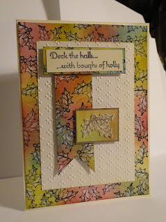 Christmas card with holly pattern border and banner