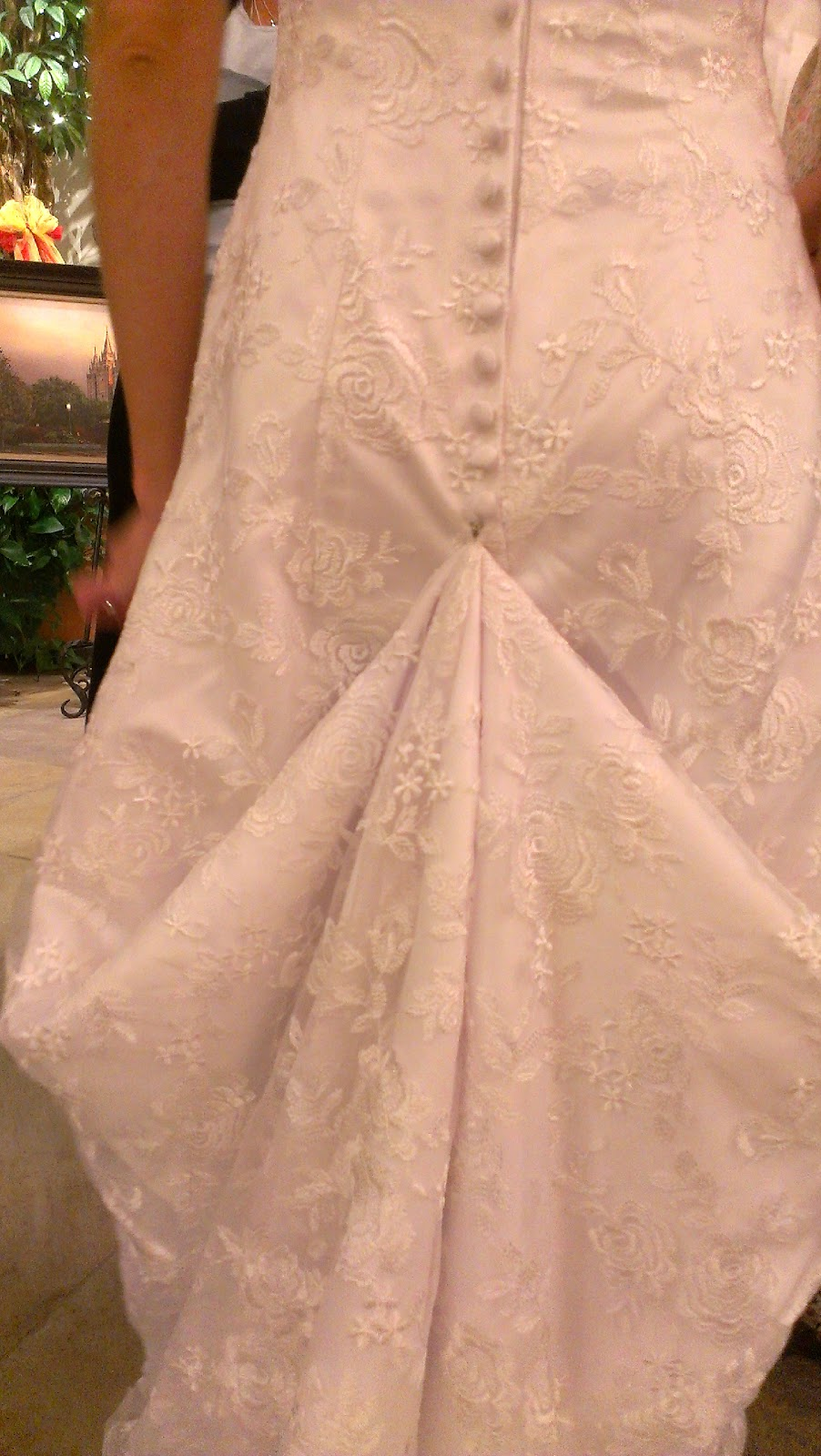 Monique 39 s boutique bustle a wedding dress for Wedding dress train bustle