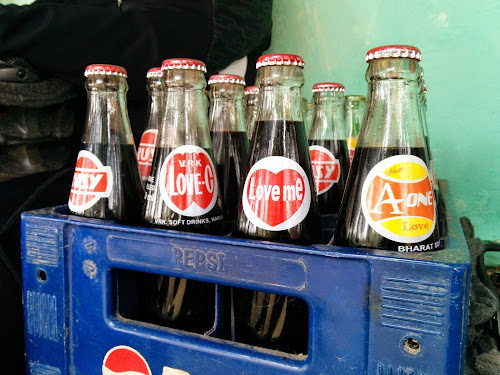 Crate with bottles of local brands of soft drinks in Tamil Nadu