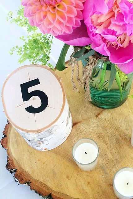 great idea for wedding table numbers- piece of wood (birch) cut at an angle + vinyl number sticker! could paint the number on too!