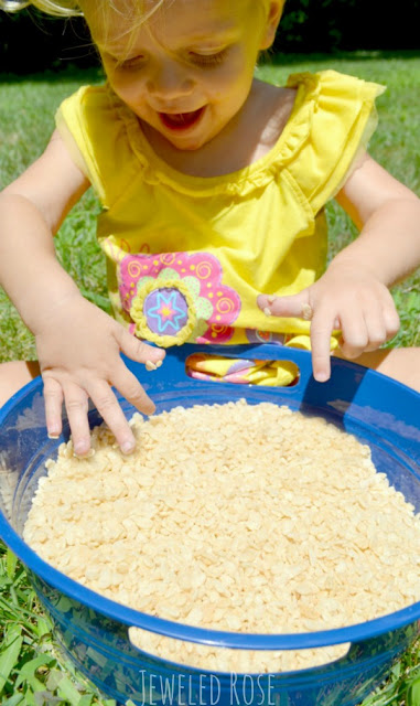 Popping rice sensory fun for kids.  This rice is GREAT FUN dry.  Add water for sensory play with sound effects.  Give kids spray bottles of colored water to and let them paint the popping rice - talk about a FUN canvas!