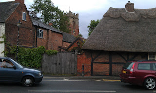 The church and thatched cottages in Dunchurch 