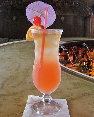 Tropical drink, hurrican glass, umbrella, compound curve bar