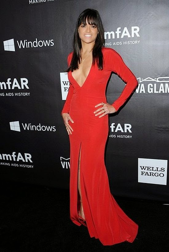 Michelle Rodriguez had nothing to be bashful about in her long red gown at amfAR party at Los Angeles, USA, on Wednesday, October 29, 2014.