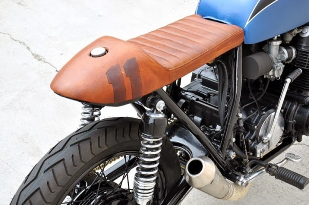 honda the babe blue 1973 honda cb750 cafe racer with matte blue fuel tank and headlamp cover brown wood seat and tail half wrapped 4 into 1 exhaust pipe custom upside down front fork disc br