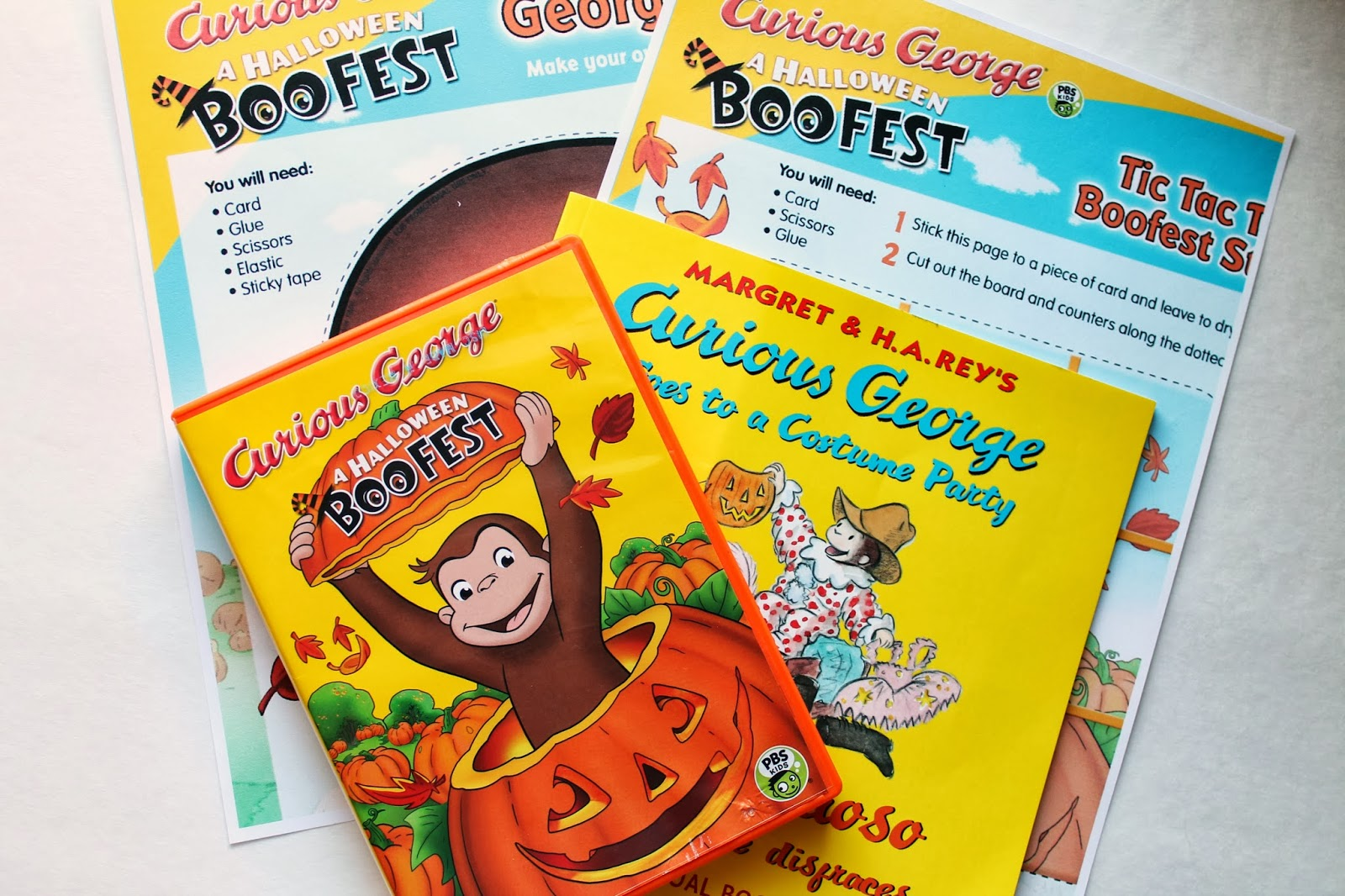 she loves hearing both the english and spanish versions of the story its a story about curious george attending his very first halloween party