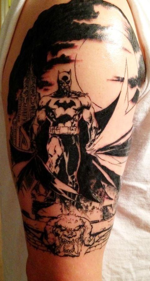Black grey batman tattoo on arm