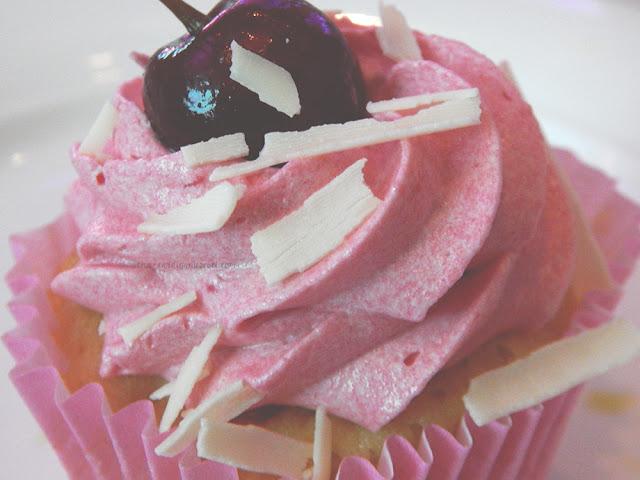 Bright pink cherry cupcake
