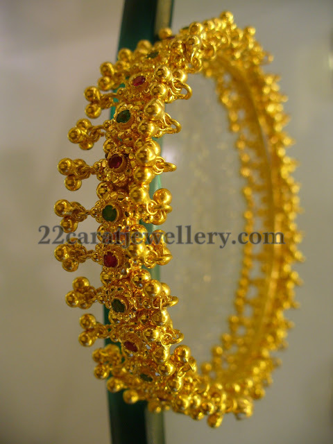 Gold Bangle with Muvvalu