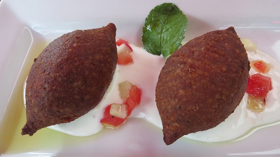 Picture of Kibbeh dish, a ground beef bulgur dumpling
