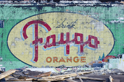 Faygo Orange Billboard from the 1940's or 1950's. Courtesy of James C. Ritchie Fine Photography