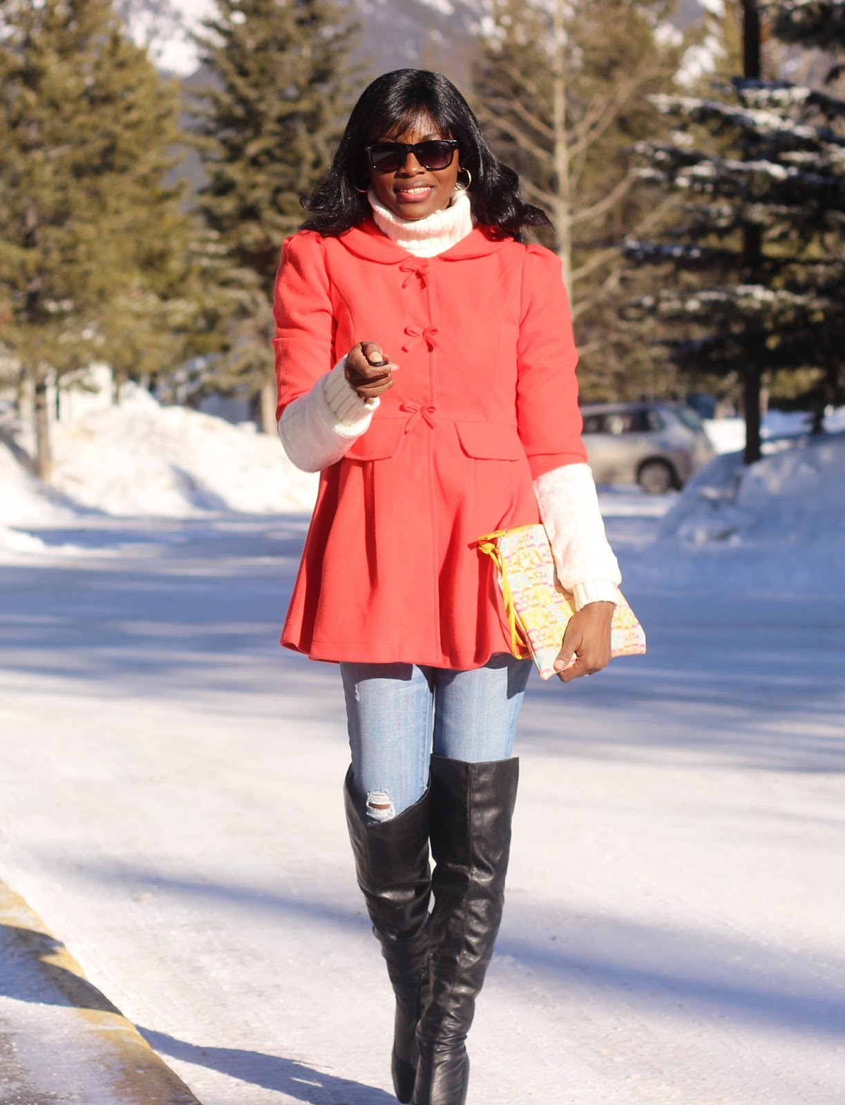 Coat dress styled with over the knee boots