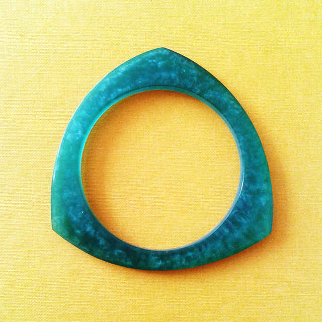 turquoise bracelet on yellow background