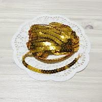 http://whereideasbloom.com/bold-gold-string-sequins/