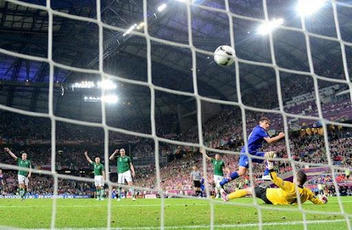 Croatia striker Nikica Jelavić shoots to score a goal against Republic of Ireland