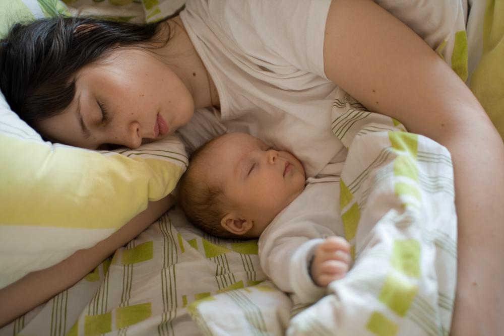 Imagini pentru baby sleeping with mom