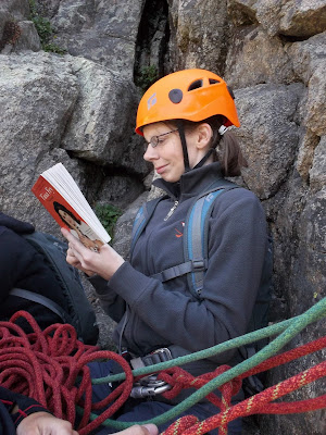 Taking a break from rock-climbing to read Bossy Pants