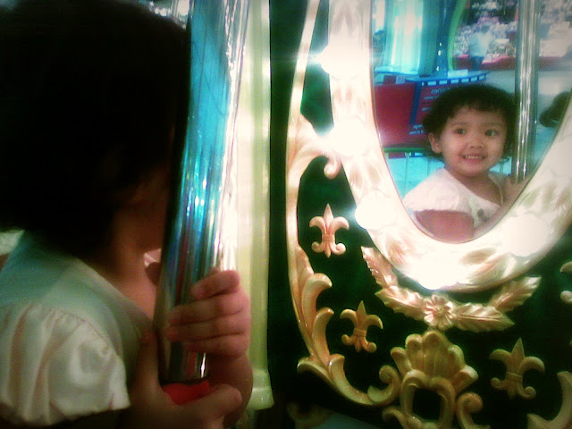 Mirror image of Kecil on the carousel