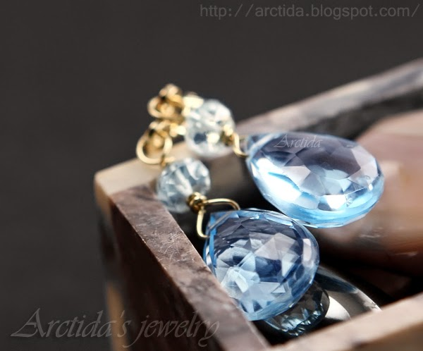 http://www.arctida.com/en/solid-gold-14k/60-aquamarine-sky-blue-topaz-earrings-14k-solid-gold-calypso.html