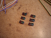 2mm red, green, and yellow LEDs glued to the back of each traffic light face plate