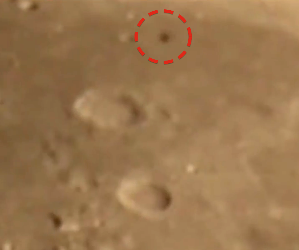 Dark UFO Caught Flying Along Moons Surface, UFO Sightings