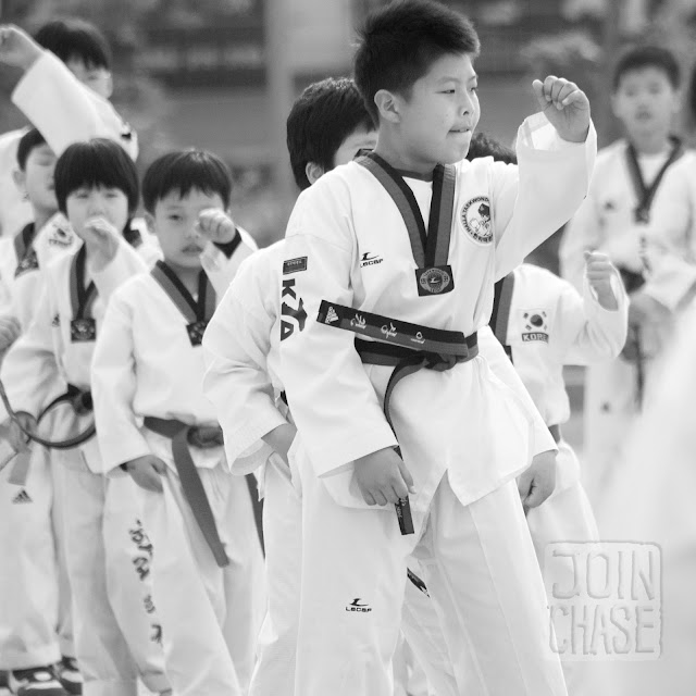 Korean students doing Taekwondo during Sports Day at Bibong Elementary in Ochang, South Korea.