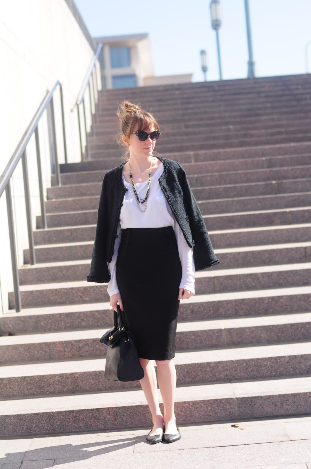 Black boucle jacket, black pencil skirt, white tee, black flats.