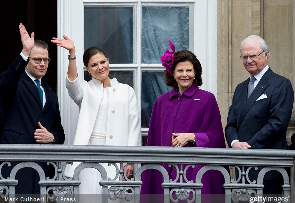 King Carl XVI Gustaf of Sweden and Queen Silvia of Sweden with Crown Princess Victoria of Sweden and Prince Daniel, Duke of Vastergotland on the balcony at Amalienborg Palace during festivities for the 75th birthday of Queen Margrethe II Of Denmark