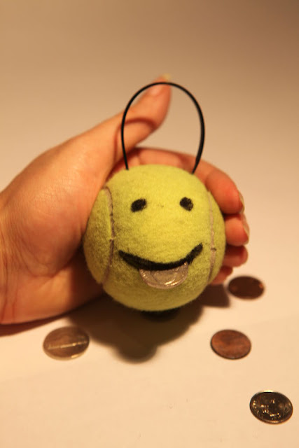 Portamonete con il riuso creativo delle palline da tennis