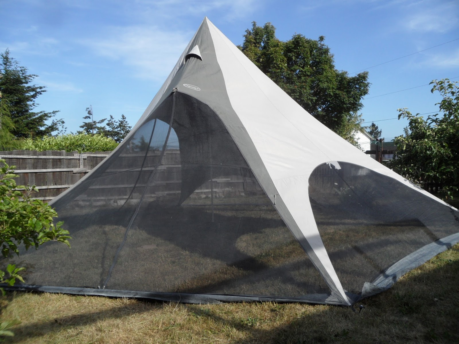 Here are a few parting photos of the North Pole Shade Tent as it sits in the backyard. & Four Bees: North Pole Shade Tent Burning Man Shade Revisited!