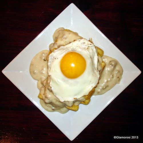 Sausage Gravy and Cornbread Waffle with Fried Egg at Chhaya Café