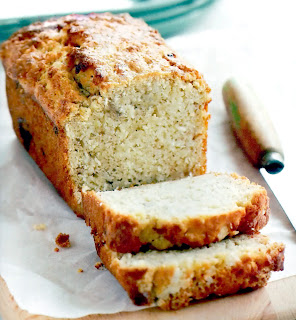 Classic banana-based loaf containing coconut in the batter served sliced for tea time