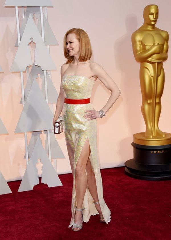 We're really loving how relaxed and refreshed Nicole Kidman seems, looks like a little journey on Oscar's red carpet totally hit the spot.  The summer look with gorgeous Louis Vuitton design were placing in all right places as she strolled around the 87th Annual Academy Awards at Hollywood on Sunday, February 22, 2015.