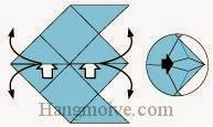 Bước 8: Từ vị trí mũi tên, mở hai lớp giấy ra, kéo và gấp hai cạnh giấy về phía bên ngoài.